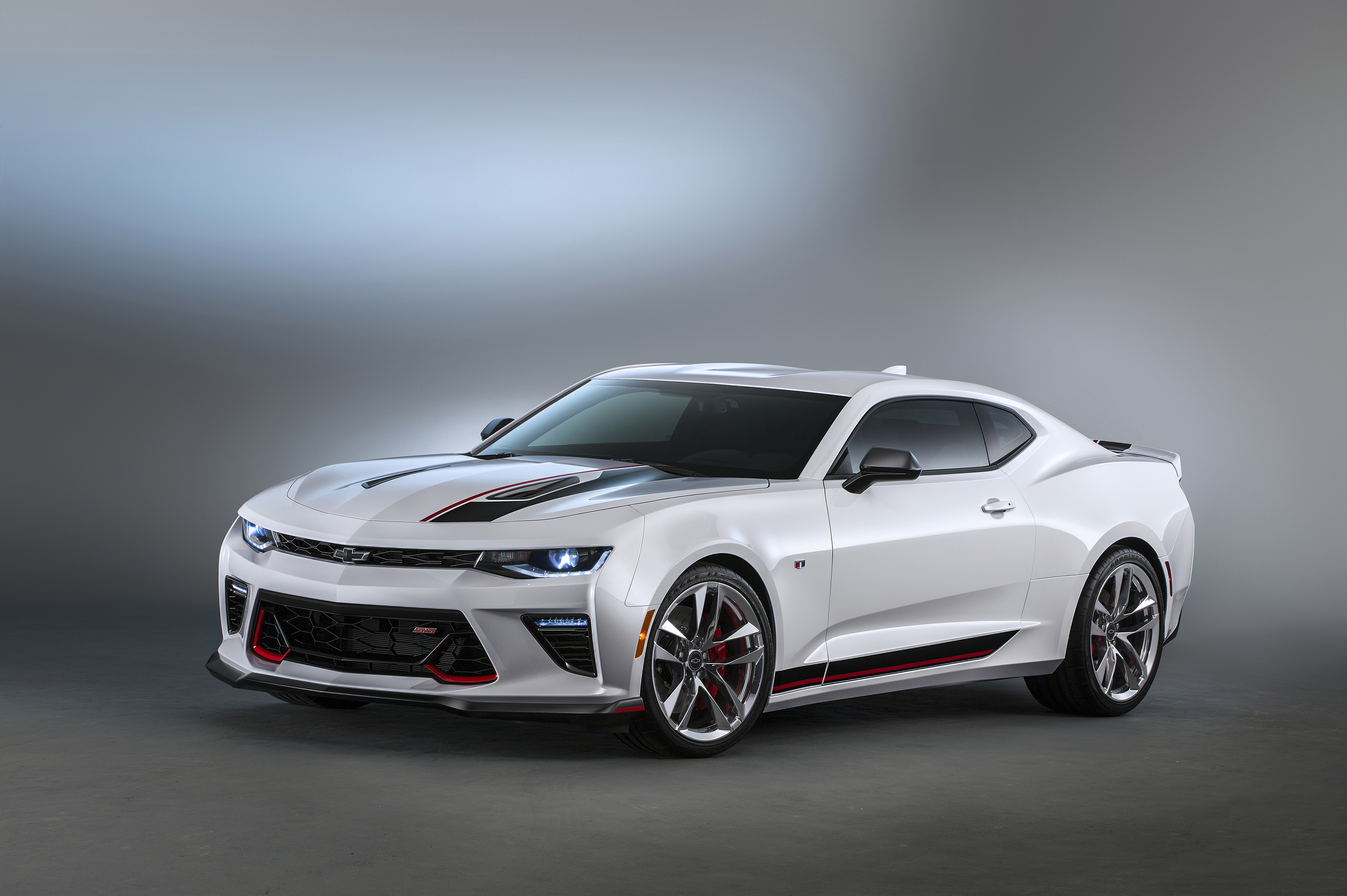 Camaro Chevrolet Performance concept – The Summit White Camaro SS features new red accents, custom 20-inch forged aluminum wheels, lowered suspension and performance upgrades.