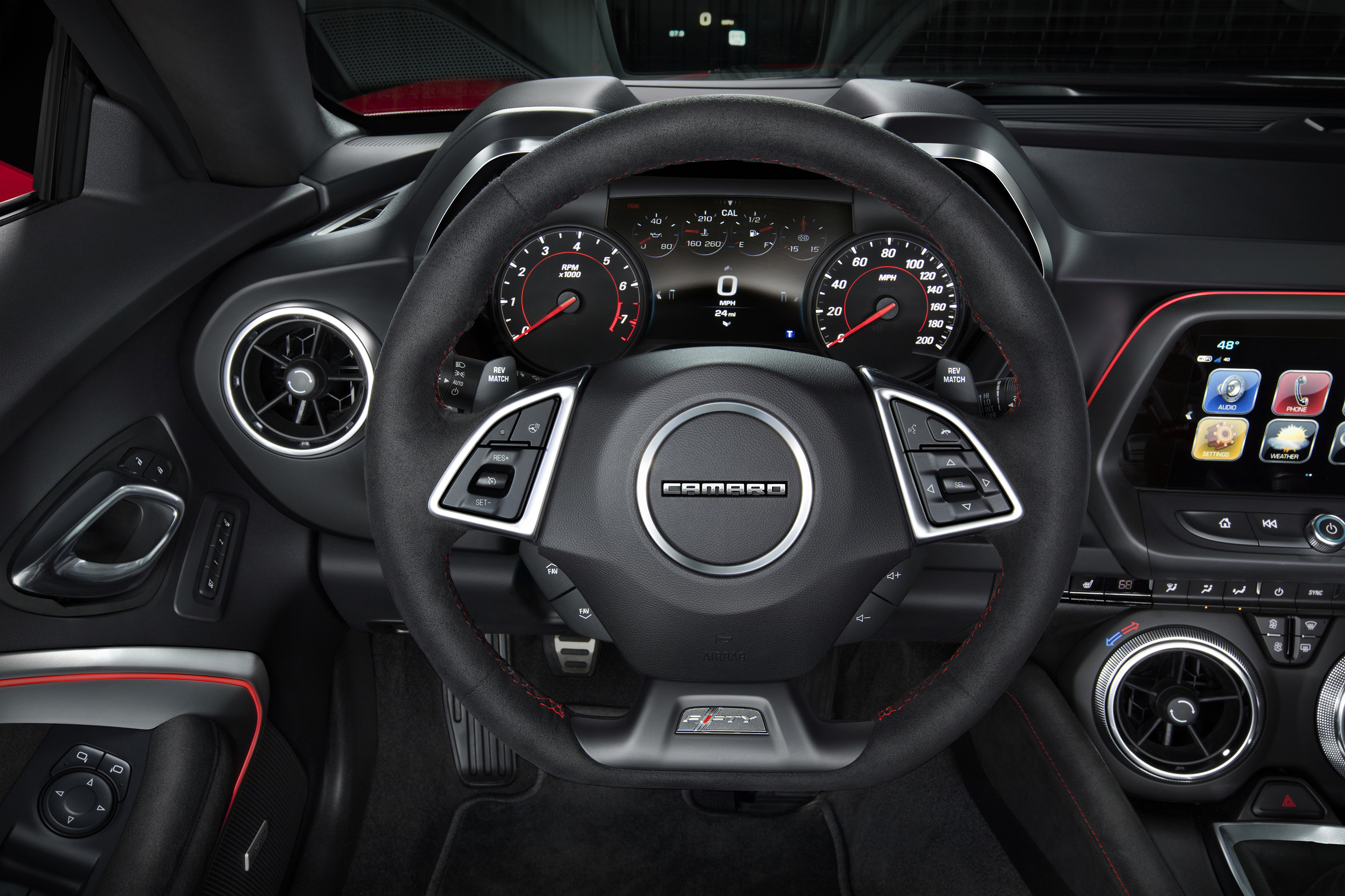 The driver-focused interior of the Camaro ZL1 features standard Recaro front seats, along with a sueded flat-bottom steering wheel and shift knob. Chevrolet's Performance Data Recorder is available, and allows drivers to record, share and analyze driving experiences on and off the track.